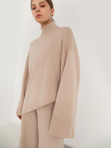 Asymmetric ribbed-knit turtleneck sweater
